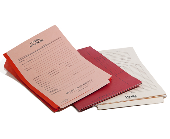 Custom printed docket forms on front and inside of Patent and Trademark folders.